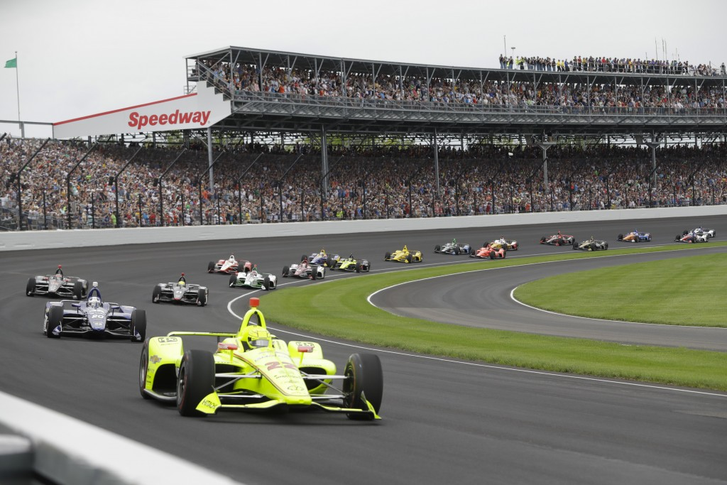 FILE - In this May 26, 2019, file photo, Simon Pagenaud, of France, leads the field through the first turn on the start of the Indianapolis 500 IndyCa...