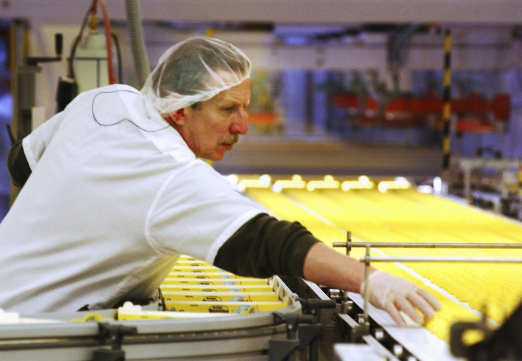 FILE - In this April 2, 2003 file photo, a worker at the Just Born factory in Bethlehem, Pa., keeps an eye on the Marshmallow Peeps that pass by on th...