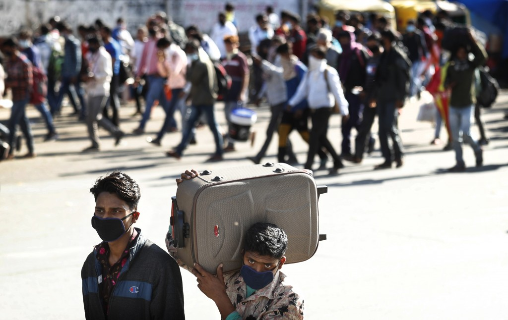 Migrant daily wage laborers make the journey to their respective villages on foot following a lockdown amid concern over spread of coronavirus in New ...