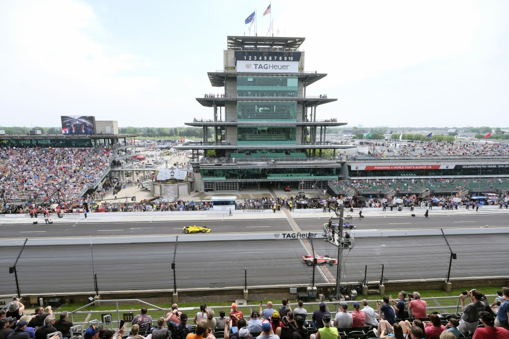 FILE - In this May 24, 2019, file photo, cars take to the track during the final practice session for the Indianapolis 500 IndyCar auto race at Indian...