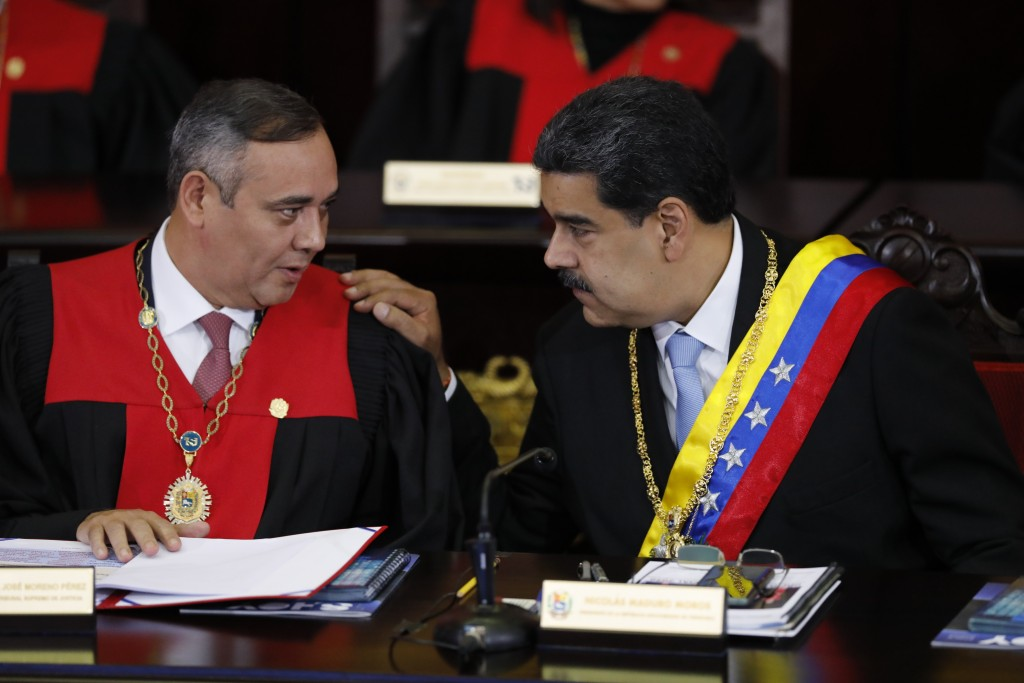 FILE - In this Jan. 31, 2020 file photo, Venezuelan President Nicolas Maduro, right, speaks with Supreme Court President Maikel Moreno at the Supreme ...