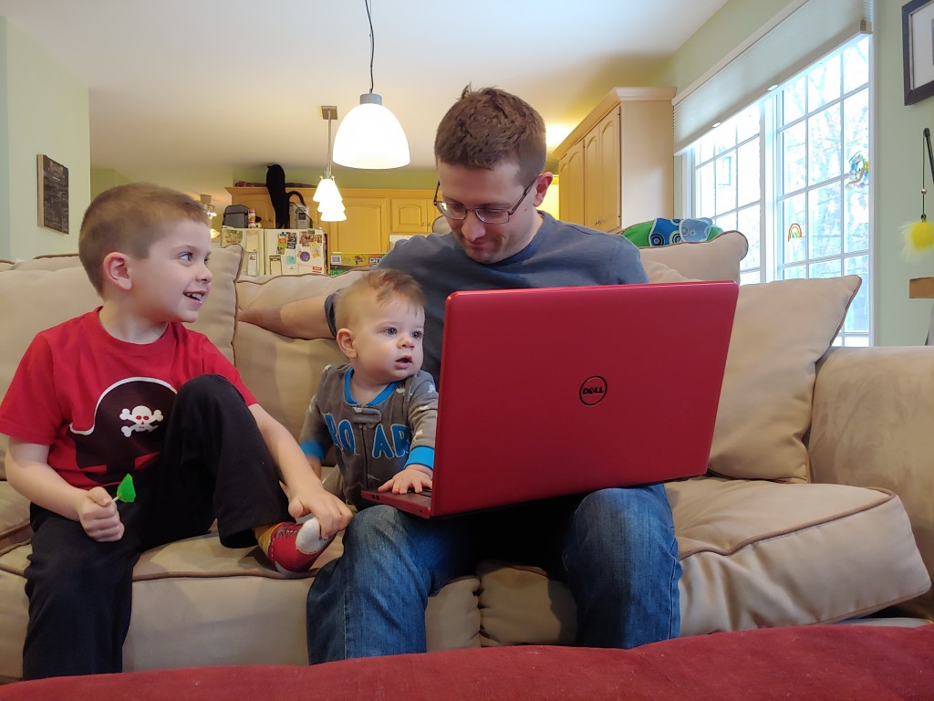 This image released by Caren Tolleth shows her husband Michael posing with their sons Gavin, 5, left, and Emmett, 9 months, at their home in Gillette,...