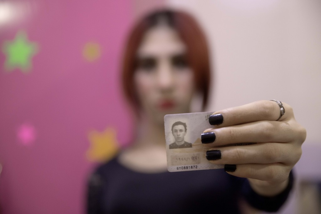 In this Oct. 28, 2019 photo, transgender woman Malak el-Kashif shows her identification card that has not been changed after her transition, in Cairo,...