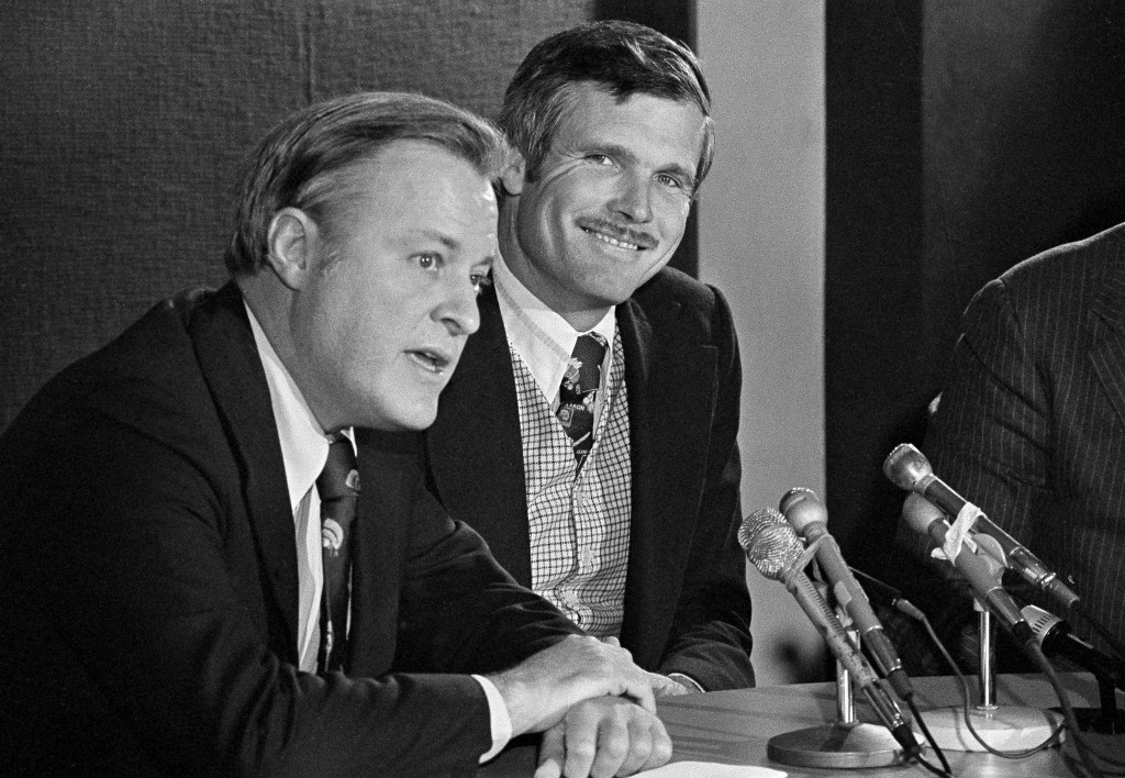 FILE - In this Jan. 7, 1976, file photo, Atlanta Braves chairman Bill Bartholomay, left, and Atlantan Ted Turner, talk with newsmen after it was annou...