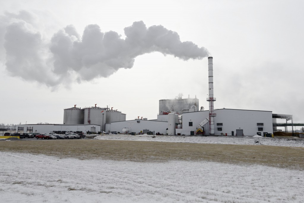 FILE - In this Jan. 6, 2015 file photo steam blows over the Green Plains ethanol plant in Shenandoah, Iowa. As hospitals and nursing homes run out of ...