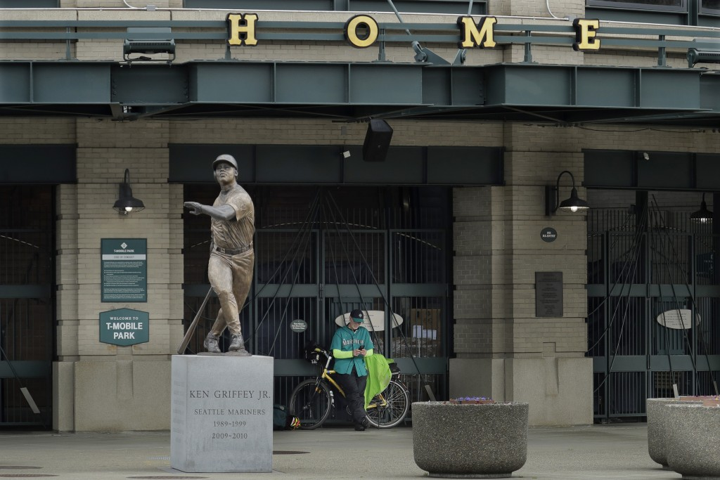 Al Jackson, a die-hard Seattle Mariners fan and 11-year season ticket holder, leans against the gate at the home plate entrance near the Ken Griffey J...