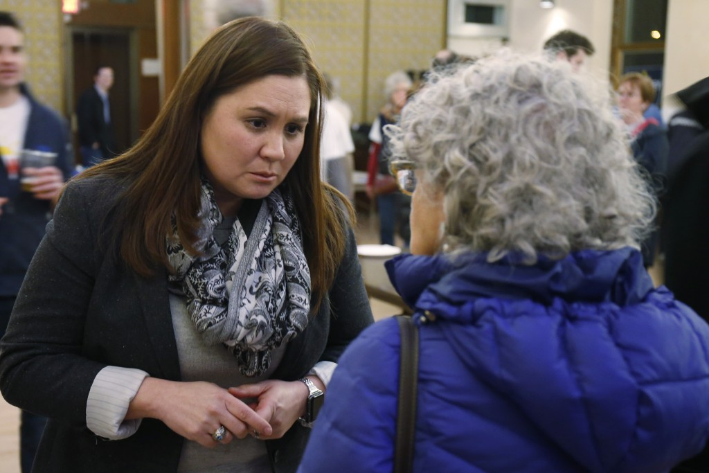 FILE—In this file photo from Feb. 18, 2020, Nikki Foster, Democratic candidate for Ohio's first congressional district, greets a woman following a que...