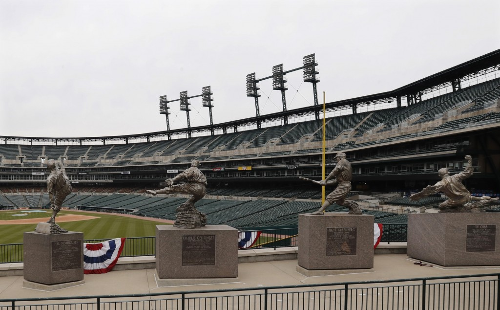 The statues of, from left, Hal Newhouser, Charlie Gehringer, Hank Greenberg and Ty Cobb stand in left field inside Comerica Park, home of the Detroit ...
