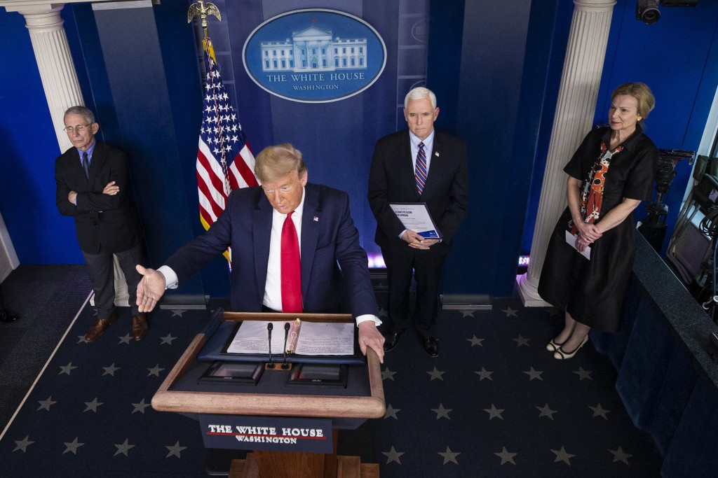 FILE - In this March 26, 2020, file photo President Donald Trump speaks about the coronavirus accompanied by Dr. Anthony Fauci, left, director of the ...