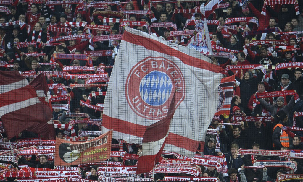FILE - In this Wednesday, March 11, 2015 file photo, Bayern fans wave flags and scarfs before their Champions League soccer match against Shakhtar Don...