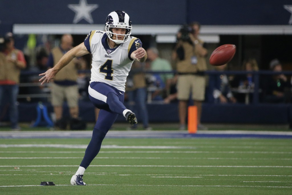FILE - In this Dec. 15, 2019, file photo, Los Angeles Rams kicker Greg Zuerlein (4) kicks during an NFL football game against the Dallas Cowboys in Ar...