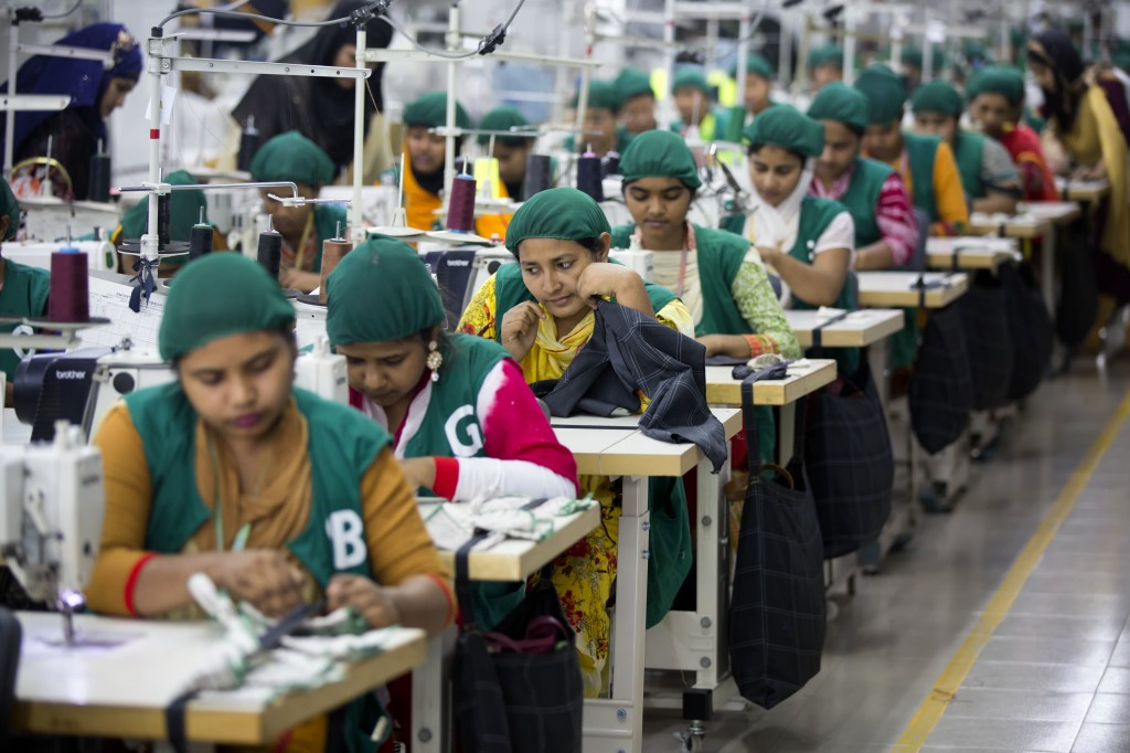 FILE - In this April 19, 2018 file photo, trainees work at Snowtex garment factory in Dhamrai, near Dhaka, Bangladesh. A survey of factory owners in B...