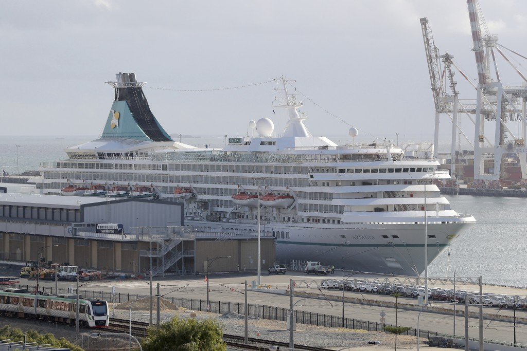 This Friday, March 27, 2020, photo shows the cruise ship Artania docked at Fremantle harbour in Fremantle, Australia. Authorities were still hoping to...