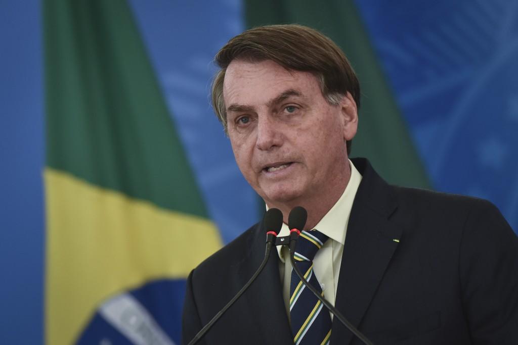Brazil's President Jair Bolsonaro speaks to journalists about the new coronavirus at Planalto presidential palace in Brasilia, Brazil, Friday, March 2...