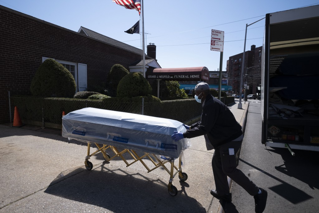 William Samuels delivers caskets to the Gerard Neufeld Funeral Home, Friday, March 27, 2020 during the coronavirus pandemic in the Queens borough of N...