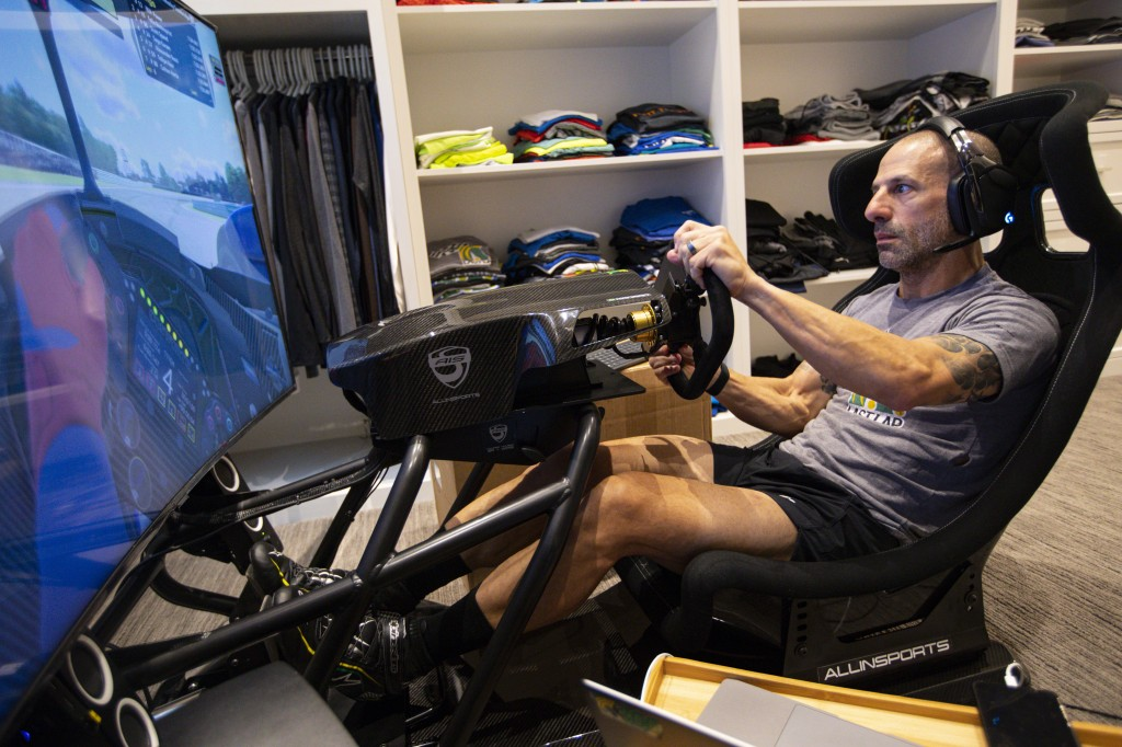 IndyCar driver Tony Kanaan, of Brazil, practices on his racing simulator in his home in Indianapolis, Saturday, March 28, 2020. Kanaan, along with oth...