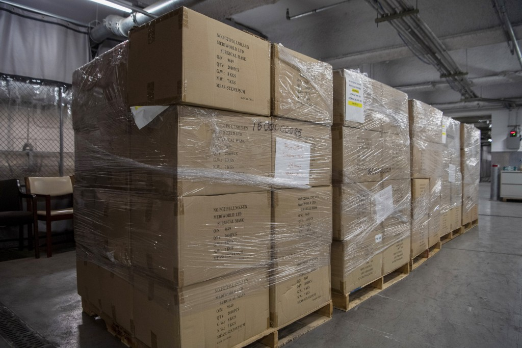 In this March 28, 2020 photo provided by the United Nations, pallets containing 250,000 face masks rest on a landing dock at United Nations headquarte...