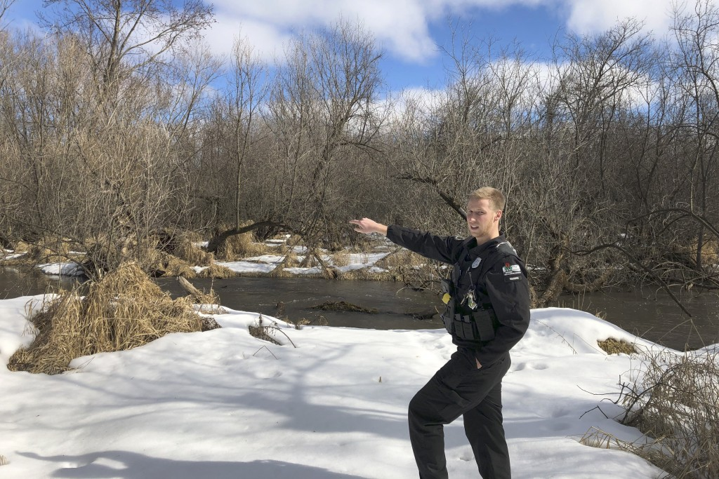 In this March 5, 2020 photo, Wisconsin Department of Natural Resources Warden Austin Schumacher stands on the edge of a marsh in Edgerton, Wis., where...