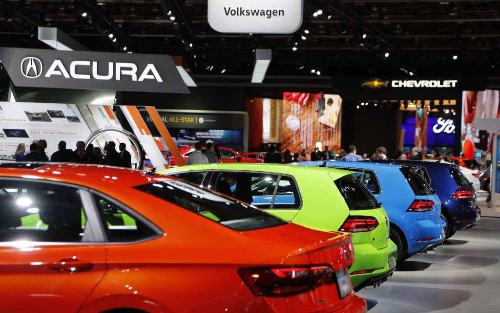 FILE - In a Jan. 15, 2019 file photo, signage for automakers Volkswagen, Acura, Chevrolet and Ford, at the North American International Auto Show in D...