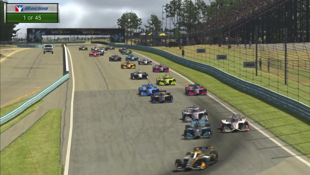 In this image taken from video provided by iRacing IndyCar, IndyCar Pato O'Ward, foreground, heads into a turn during opening lap of the American Red ...