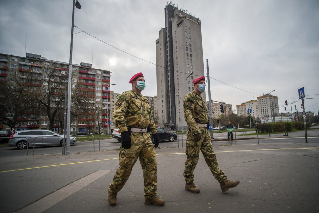 Two members of the military police patrol the streets in Budapest, Hungary, Monday, March 30, 2020. Due to the coronavirus pandemic, two days earlier ...