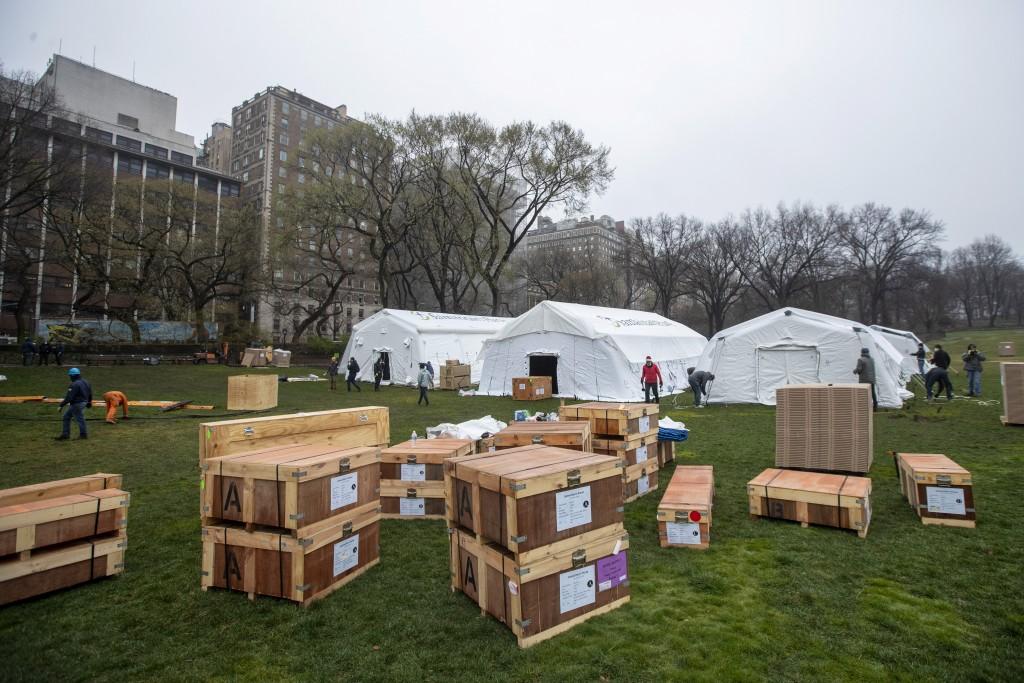 A Samaritan's Purse crew works on building an emergency field hospital equipped with a respiratory unit in New York's Central Park across from the Mou...