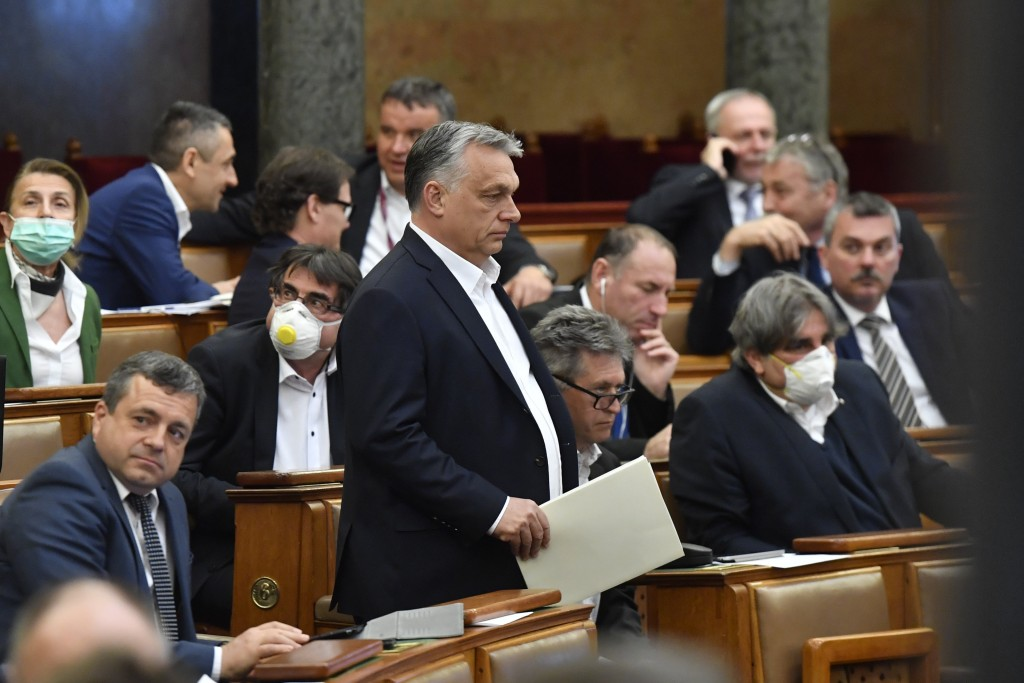 Hungarian Prime Minister Viktor Orban arrives for the plenary session of the Parliament in Budapest, Hungary, Monday, March 30, 2020. Later MPs approv...