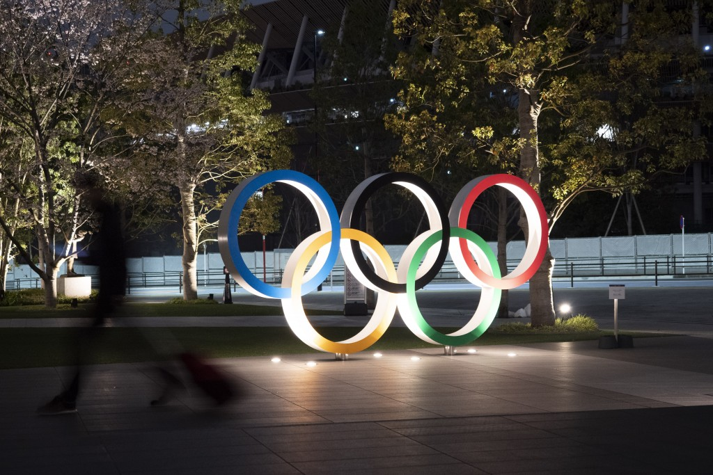 The Olympic rings are seen Monday, March 30, 2020, in Tokyo. The Tokyo Olympics will open next year in the same time slot scheduled for this year's ga...