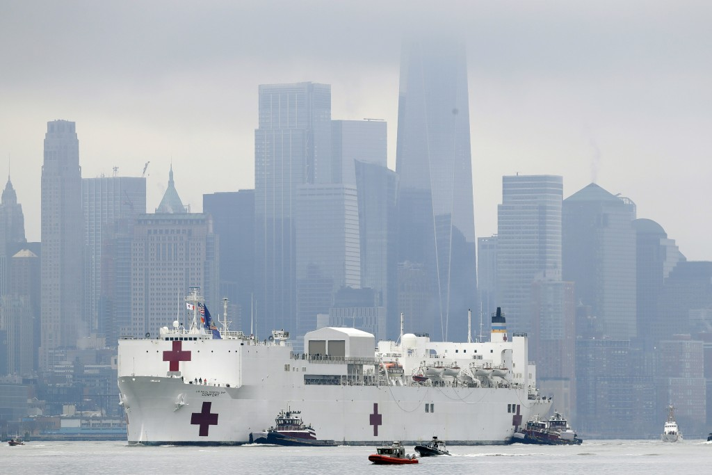 The Navy hospital ship USNS Comfort passes lower Manhattan on its way to docking in New York, Monday, March 30, 2020. The ship has 1,000 beds and 12 o...