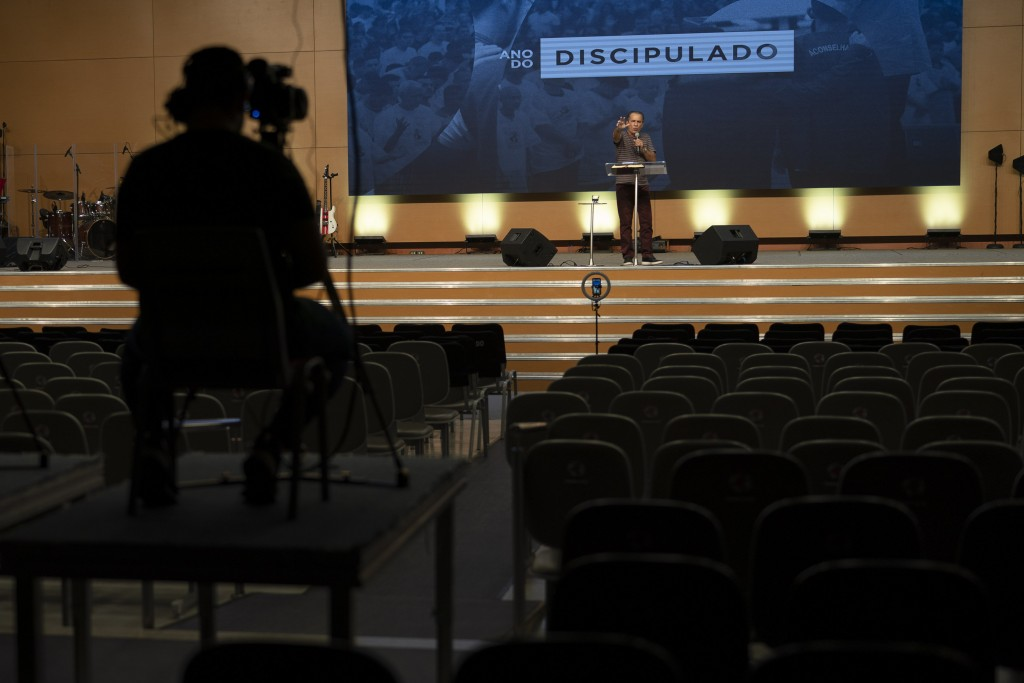 Pastor Silas Malafaia delivers a sermon transmitted live through social networks, from inside the empty Assembly of God Victory in Christ Church, amid...