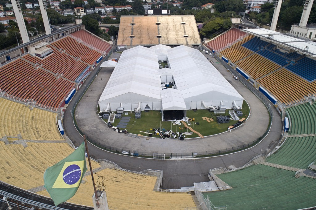 Workers set up a temporary field hospital to treat patients who have COVID-19 inside Pacaembu stadium in Sao Paulo, Brazil, Monday, March 30, 2020. (A...