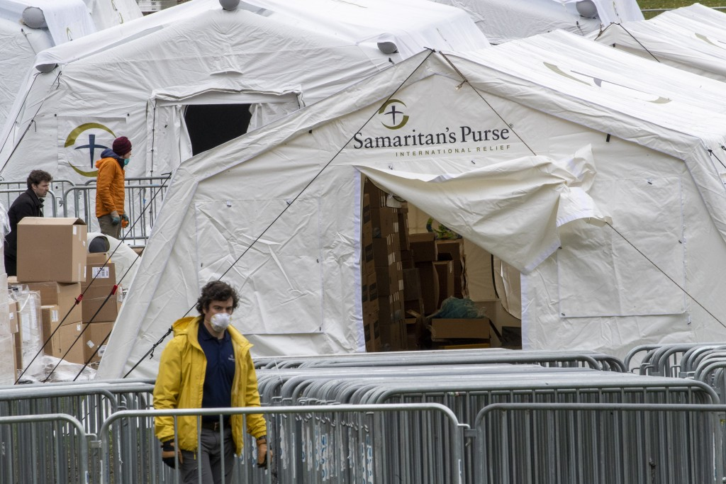 A Samaritan's Purse crew and medical personnel work on preparing to open a 68 bed emergency field hospital specially equipped with a respiratory unit ...