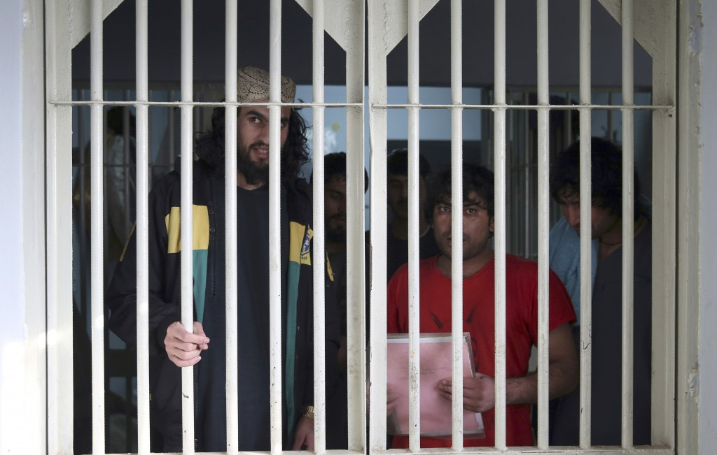 FILE - In this Dec. 14, 2019 file photo, jailed Taliban are seen inside the Pul-e-Charkhi jail in Kabul, Afghanistan. A three-member Taliban technical...
