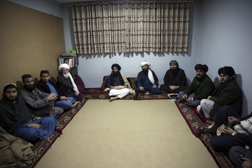 FILE - In this Dec. 14, 2019 file photo, jailed Taliban sit inside the Pul-e-Charkhi Jail after speaking with The Associated Press, in Kabul, Afghanis...