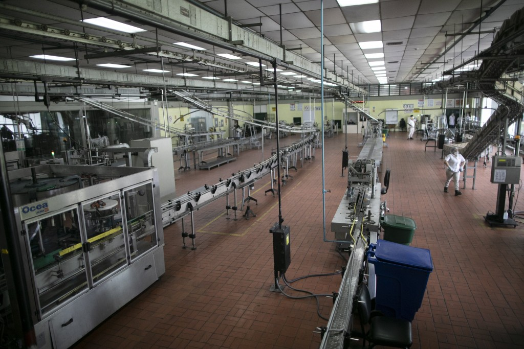 The assembly room is almost empty at the Santa Teresa rum factory while under 10 percent of workers are on duty, due to the new coronavirus in La Vict...