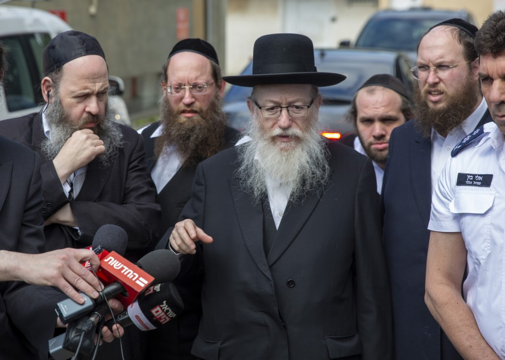 In this Monday, March 2, 2020 photo, Israel's Health Minister Yaakov Litzman delivers a statement as he visits a makeshift tent for quarantined corona...