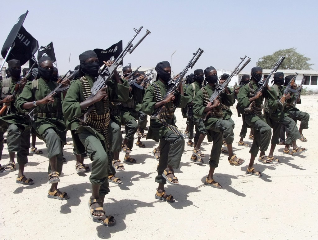 FILE - In this Feb. 17, 2011, file photo, hundreds of newly trained al-Shabab fighters perform military exercises in the Lafofe area south of Mogadish...