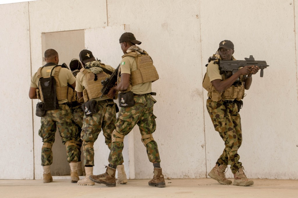 FILE - In this Feb. 18, 2020, file photo, Nigerian Navy Special Boat Service troops exercise under the supervision of British special forces during U....
