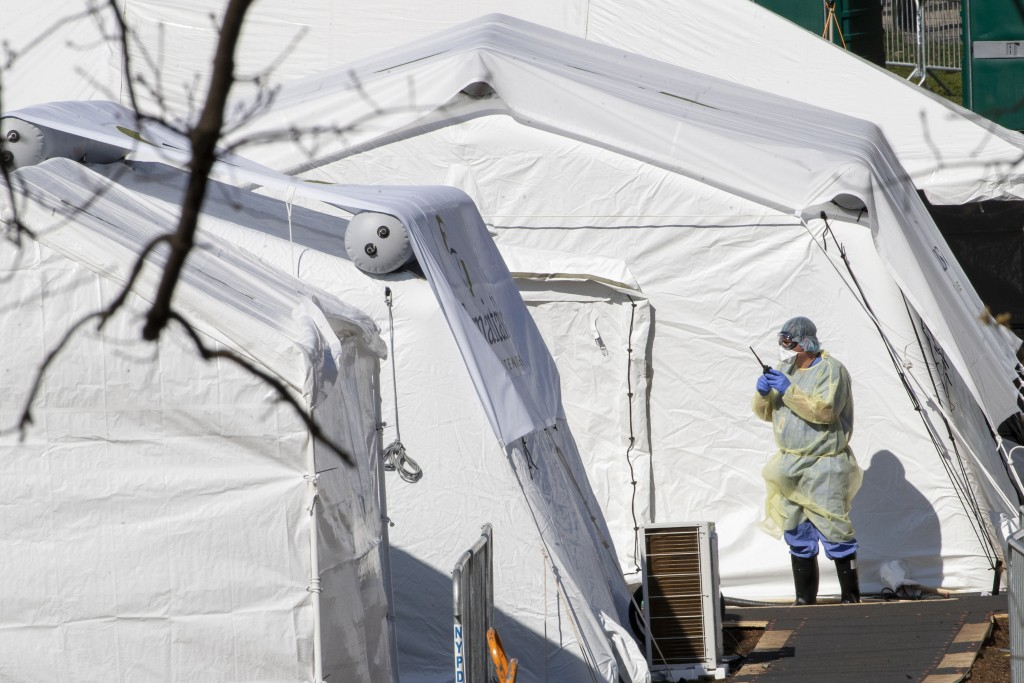 A medical personnel wears personal protective equipment while working at the Samaritan's Purse field hospital  in New York's Central Park, Wednesday, ...