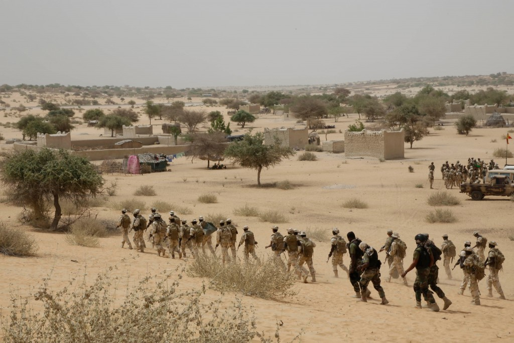 FILE - In this March 7, 2015, file photo, Chadian troops and Nigerian special forces participate in the Flintlock exercises with the U.S. military and...