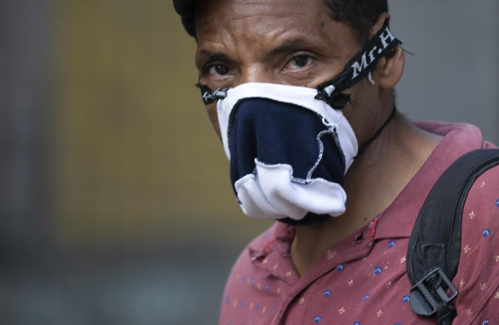 A pedestrian wears a home made mask as a precaution amid the spread of the new coronavirus in Caracas, Venezuela, Thursday, April 2, 2020. (AP Photo/A...