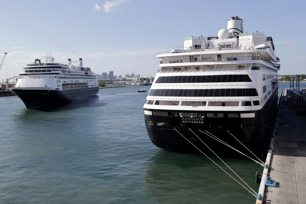 Carnival's Holland America cruise ship Rotterdam, left, arrives at Port Everglades as the Zaandam, right, is docked during the new coronavirus pandemi...