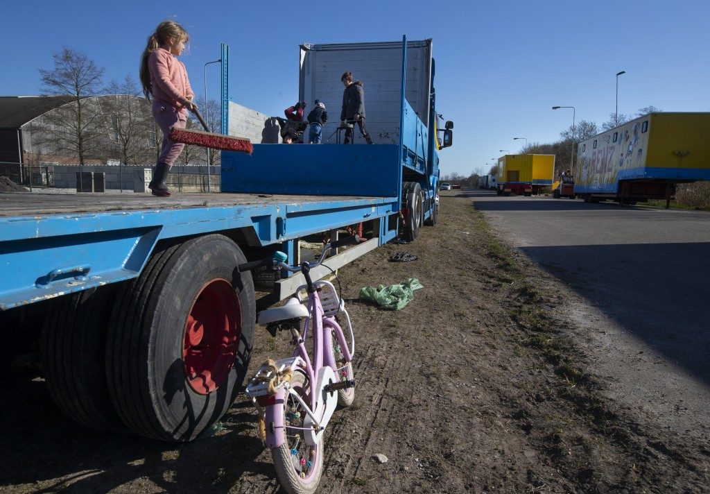 Children of the Renz Circus family play around the stranded trucks and animals in Drachten, northern Netherlands, Tuesday, March 31, 2020. The circus ...