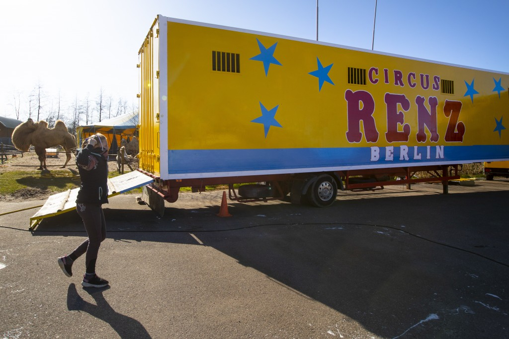 One of the children of the Renz Circus family plays around the trucks and animals stranded due to the coronavirus outbreak in Drachten, northern Nethe...