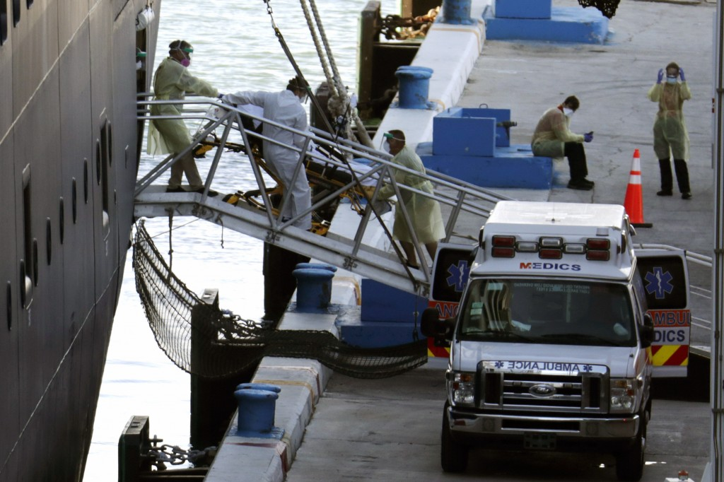 A person on a stretcher is removed from Carnival's Holland America cruise ship Zaandam at Port Everglades during the new coronavirus pandemic, Thursda...