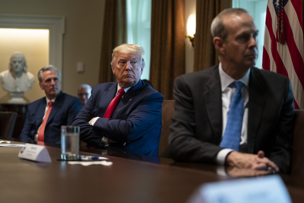 House Minority Leader Kevin McCarthy of Calif., President Donald Trump, and Chevron CEO Mike Wirth listen during a meeting with energy sector business...