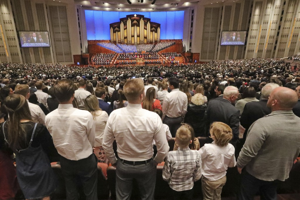 FILE - In this Oct. 5, 2019, file photo, people listen during The Church of Jesus Christ of Latter-day Saints' twice-annual church conference, in Salt...