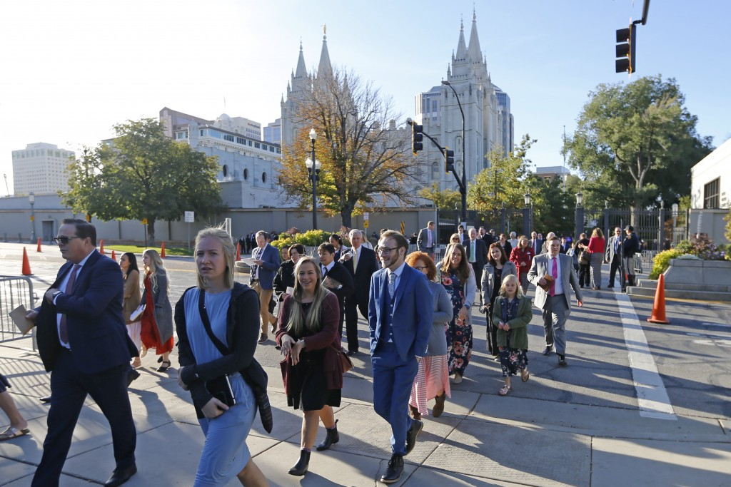 FILE - In this Saturday, Oct. 5, 2019, file photo, people arrive for The Church of Jesus Christ of Latter-day Saints' twice-annual church conference, ...