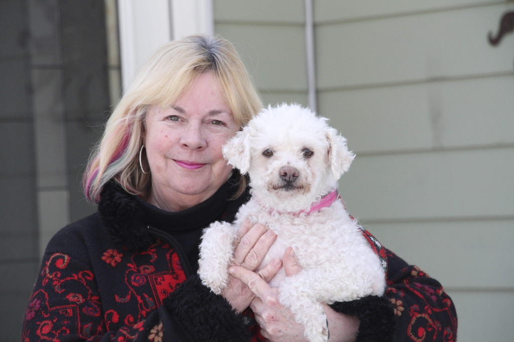 In this March 26, 2020, photo, Ina Pizzolato Offret is shown with Kelsey, a dog she and her husband, Ron, are fostering at their home in Anchorage, Al...