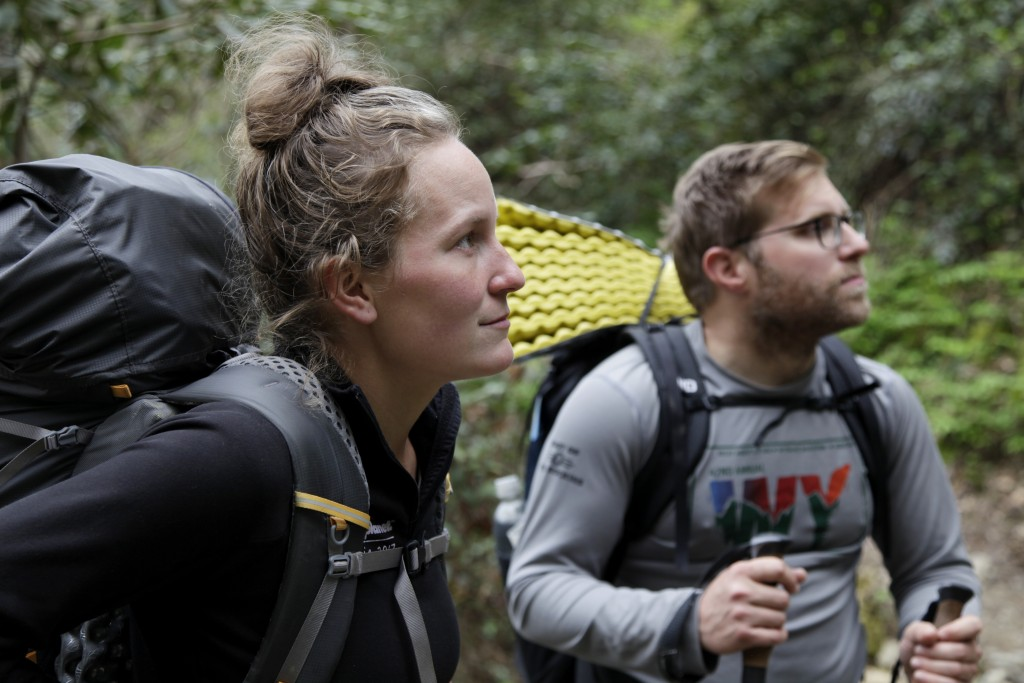 In this March 30, 2020, photo, Alexandra Eagle, left, and Jonathan Hall soak up their last moments hiking the Appalachian Trail in Cosby, Tenn. The co...